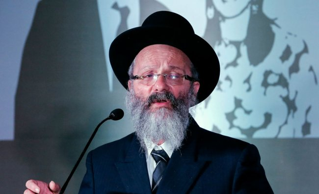 Rabbi Holtzberg speaks before the reopening ceremony of Nariman House in Mumbai ...