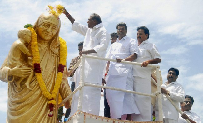 Puducherry Chief Minister N Rangaswamy paying floral tributes to a statue of Mother Teresa ...