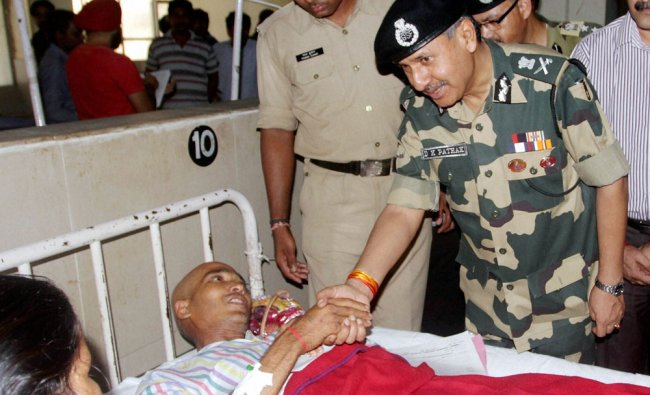 BSF DG DK Pathak interacts with a person injured in border shelling in Jammu ...