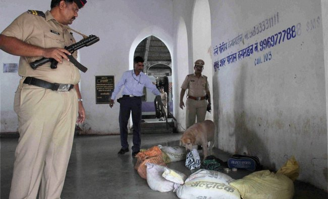 Bomb Squad members checking a suspected bag found at Bandra Station in Mumbai ...