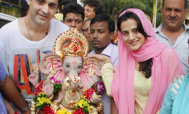 Bollywood actor Amisha Patel and family members participates in a procession for the immersion...