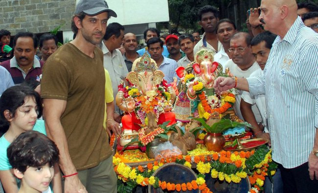 Bollywood actor Hrithik Roshan with father Rakesh Roshan and others participates in a procession...
