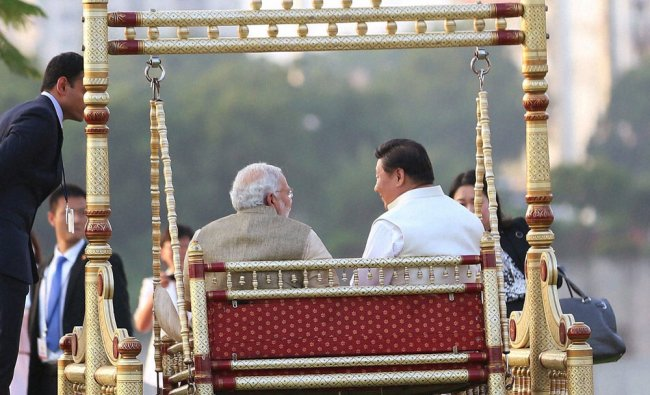 Prime Minister Narendra Modi and Chinese President Xi Jinping on a traditional swing...