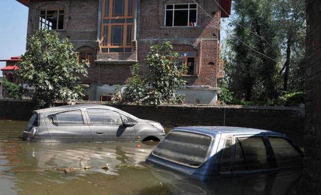 Cars submerged in flood water after the Jammu and Kashmir floods...