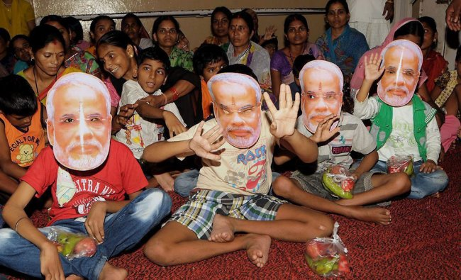 Differently-abled children wear masks of Prime Minister Narendra Modi to celebrate his birthday...