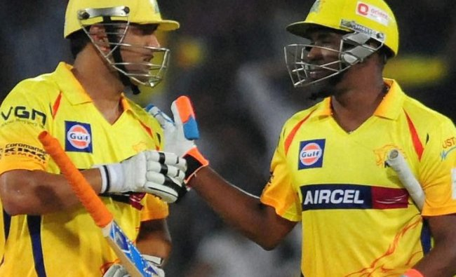 Chennai Super Kings\' M S Dhoni and Dwayne Bravo greet each other