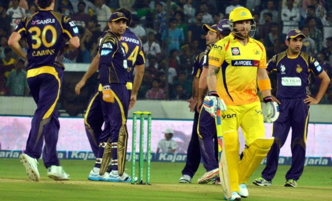 Chennai Super Kings\' Brendon McCullumi walks back after his dismissal