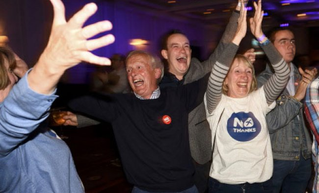 Supporters from the \'No\' Campaign react to a declaration in their favour, at the Better ...