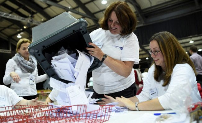 A ballot box is emptied as workers prepare to count ballots at a counting centre in Aberdeen...