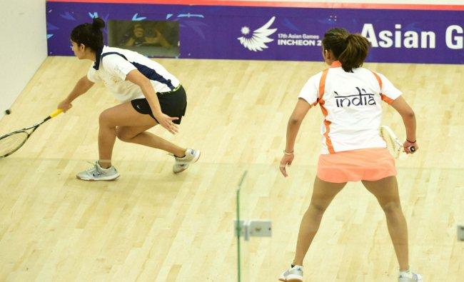 Indian squash players Dipika Pallikal and Joshna Chinappa during their (women singles)...