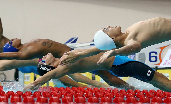 Japan\'s Ryosuke Irie center, launches off the blocks during the start of his men\'s 50m...