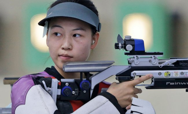 China\'s Yi Siling competes during the Women\'s 10m Air Rifle shooting competition at the 17th...