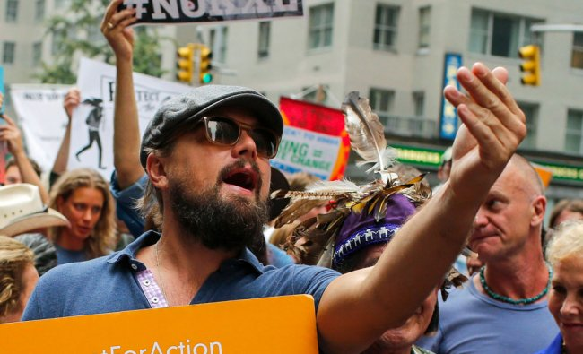 Actor Leonardo DiCaprio takes part in a march against climate change in New York, September...