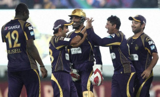 KKR captain Gautam Gambhir celebrates the wicket of Nathan Coulter-Nile of Perth Scorcher...