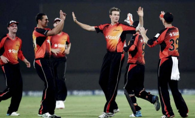 Players of Perth Scorchers celebrate the wicket of KKR captain Gautam Gambhir during...