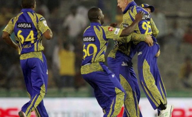 Sybrand Englebrecht of Cape Cobras celebrates with team members after winning the match...