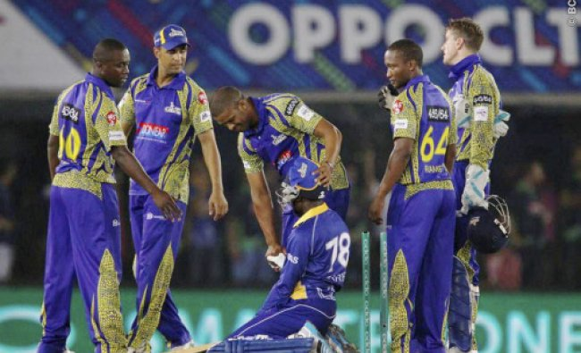 Vernon Philander of the Cape Cobras consoles Jonathan Carter after Barbados Tridents lost...