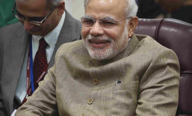 Prime Minster Narendra Modi sits in a chair at the New York Plaza Hotel ahead of his ...