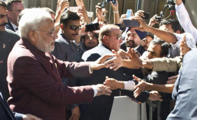 Prime Minister Narendra Modi greets people outside his hotel upon his arrival in New York ...