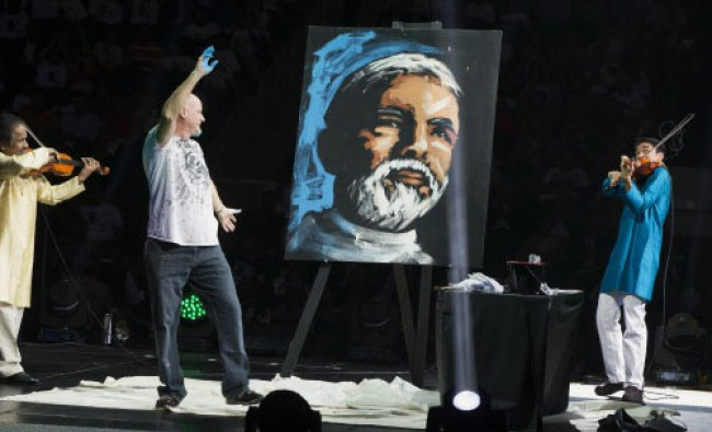 A painter reacts as he creates a portrait of India\'s Prime Minister Narendra Modi before...