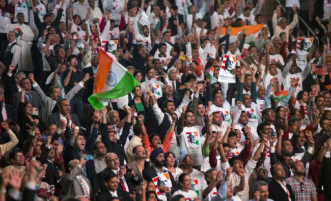 Audience members react as they attend an event with India\'s Prime Minister Narendra Modi ...