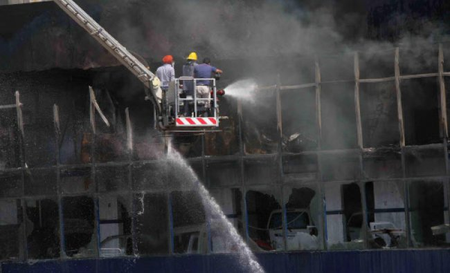 Fire tenders douse a major fire that broke out in a car service station at Sector 14...