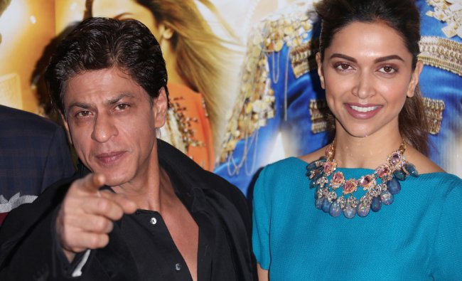 Shah Rukh Khan and Deepika Padukone pose for photographers during a photo call for Happy New Year...
