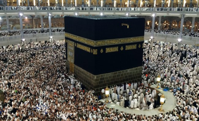 Muslim pilgrims circle the Kaaba as they pray inside the Grand Mosque during hajj...