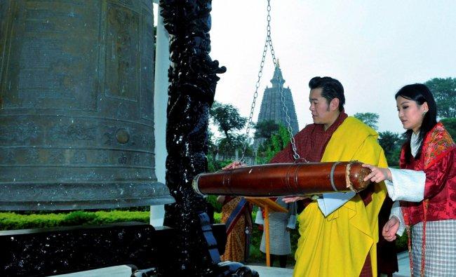Bhutan King Jigme Khesar Namgyel Wangchuck along with Queen Jetsun Pema Rings the Holy Peace bell ..