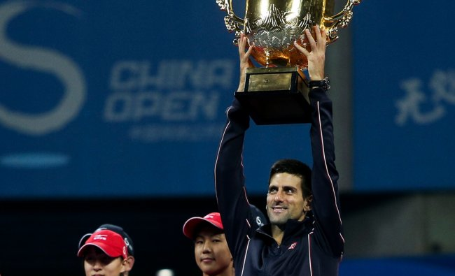 Novak Djokovic raises his trophy after he won the men\'s singles at China open ...