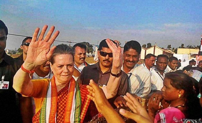 Congress President Sonia Gandhi meets supporters during an election campaign rally in Bramhapuri...
