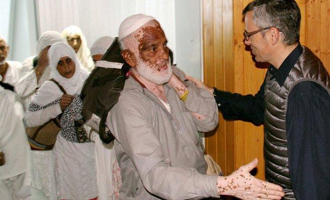 Srinagar: Jammu & Kashmir Chief Minister Omar Abdullah receives the first batch of Haj pilgrims...