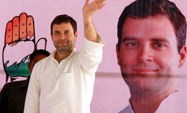 Congress Vice President Rahul Gandhi waves at an election rally in, Sirsa on Saturday...