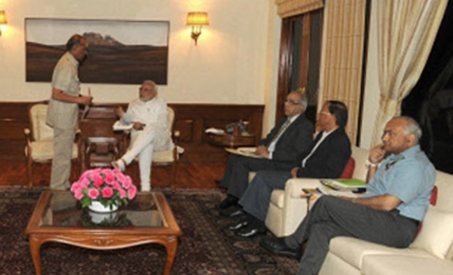 Narendra Modi chairing emergency high-level meeting to review the preparedness for Cyclone HudHud...