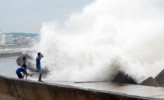 Onlookers looking at Sea tide at vizag on the eve of Cyclone Hudhud hits land...