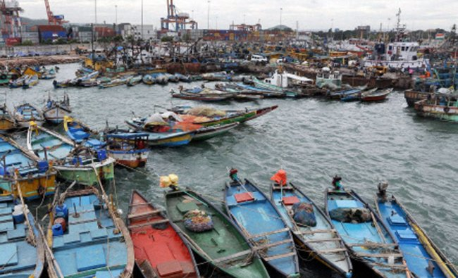 Boats anchored at the fishing harbour in Vizag after warning of Cyclone Hudhud...