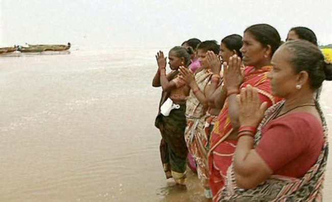 Fisherwomen pray for the relief from cyclonic storm Hudhud in Srikakulam...