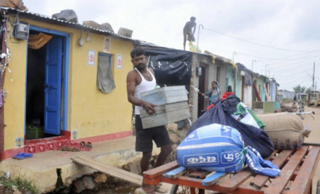 People shift with their valuables from Ghota village after warning of Cyclone Hudhud ...
