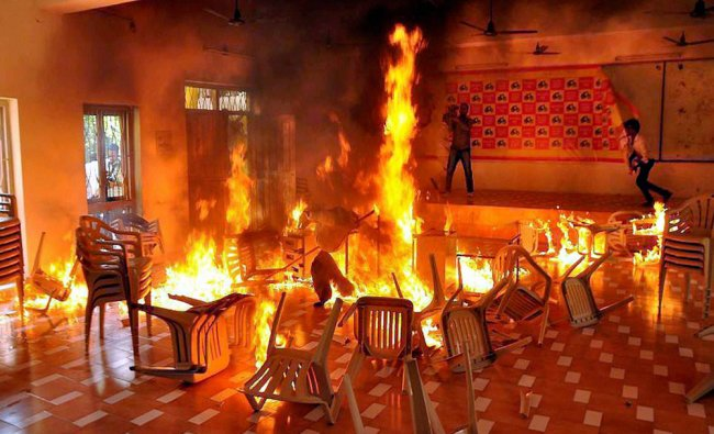 TRS activists set affire chairs at the TDP office in Nalgonda...