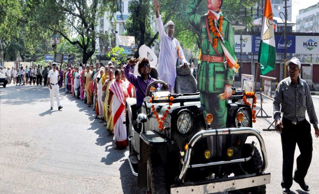 Volunteers of Azad Hind taking out a procession to mark the Azad Hind Foundation Day...