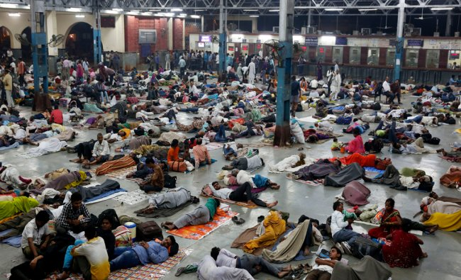 Indian passengers rest on a crowded platform ahead of Diwali, the Hindu festival of lights...