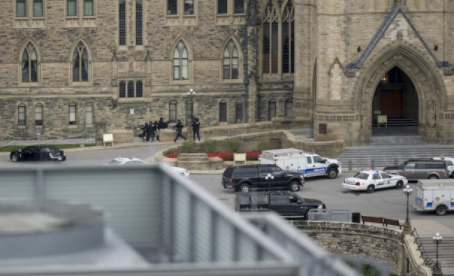Police teams enter Centre Block at Parliament Hill in Ottawa on Wednesday...