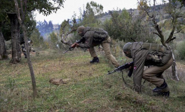 Army personnel take positions during an encounter