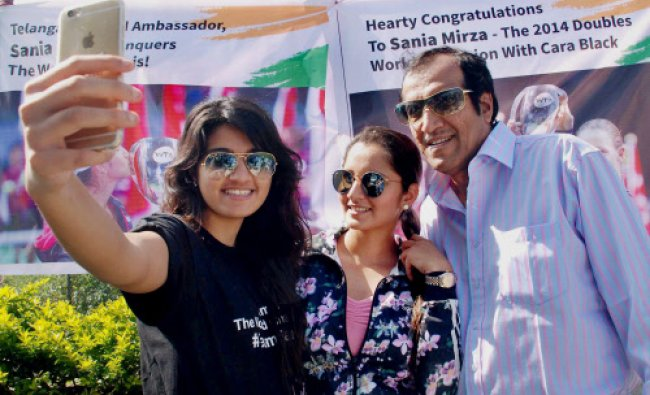 Sania Mirza poses for a selfie with her sister Anam Mirza and her father Imran...