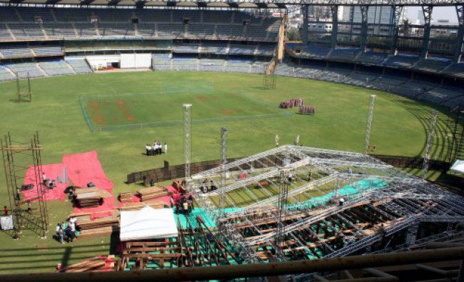 Workers build the stage at the Wankhede stadium for the swearing in ceremony...