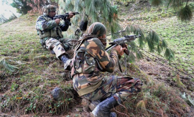 Army personnel take position during a search operation of Lashkar-e-Taiba hideouts...