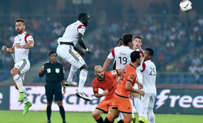 Delhi Dynamos FC (orange) and North East United FC (white) players in action during...