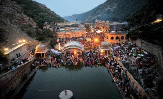 Devotees offer prayers during Chhath festival celebrations at Galta Kund in Jaipur...
