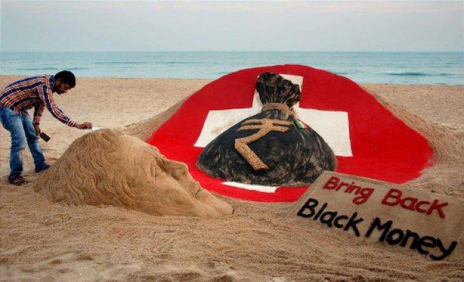 Sand artist Sudarsan Pattnaik creates a sand sculpture on Black Money with a message...
