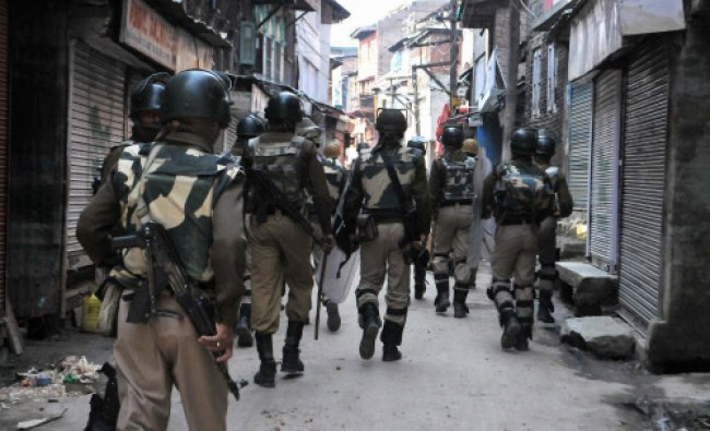 Security personnel patrol a street after a protest by the supporters of Jammu and Kashmir...
